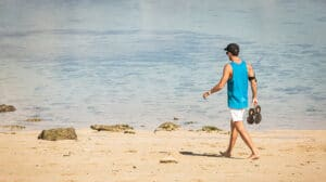 guy barefoot on beach