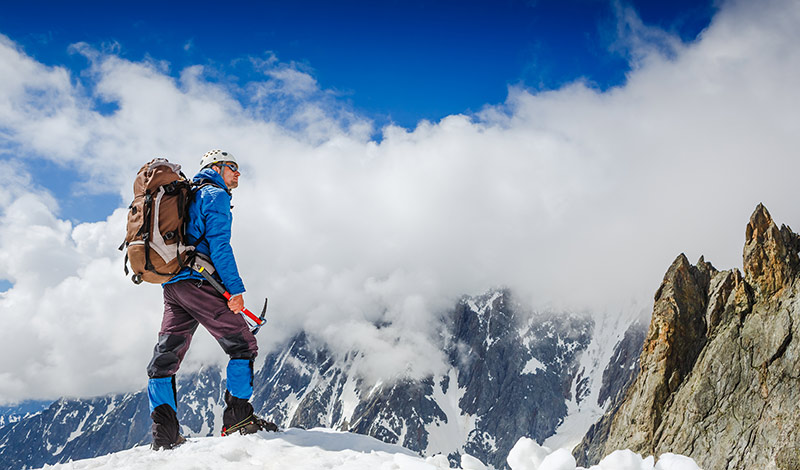 mountaineer on mountain top