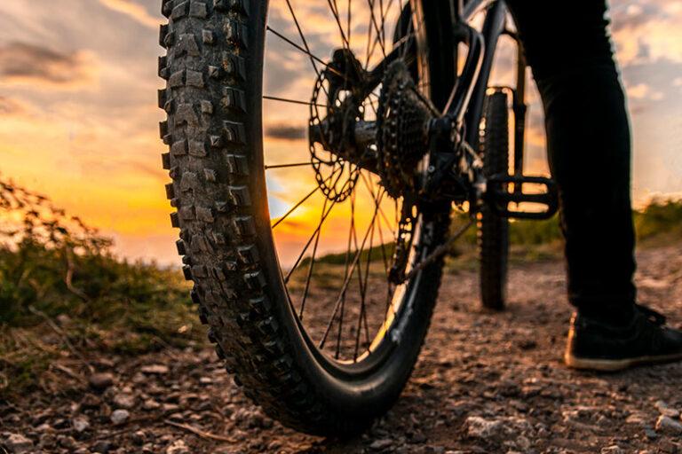 bike wheel and cyclist wearing pants
