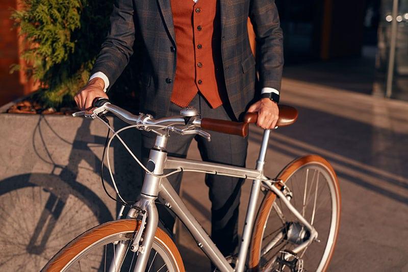man in suit bike commuting