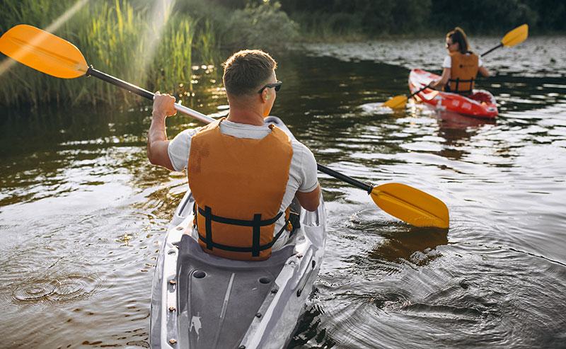 couple kayaking in lake