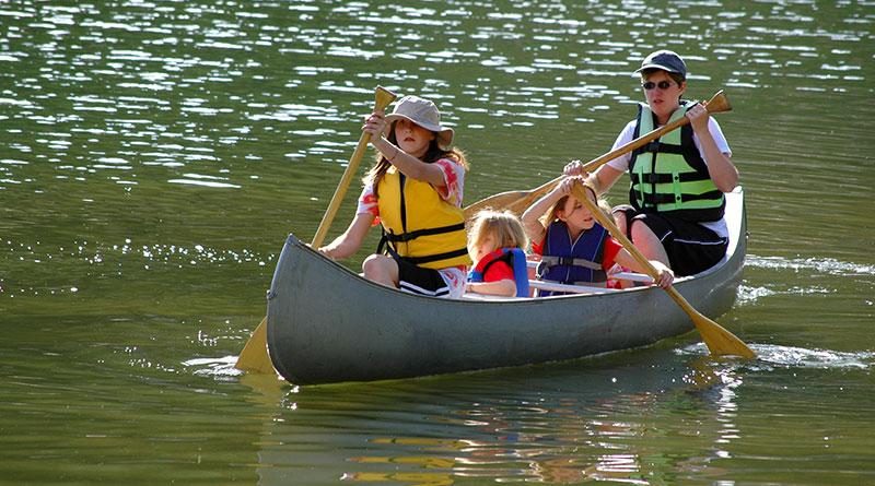 family on canoe