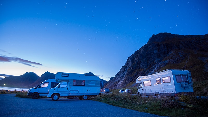 rvs parked by water