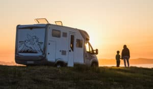 rv parked at sunset