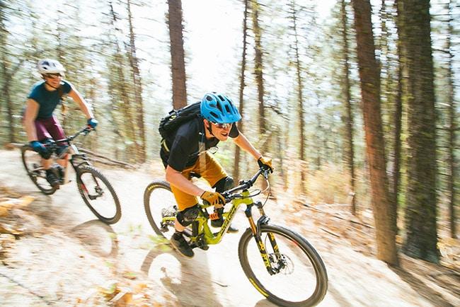 men on mountain bike trail