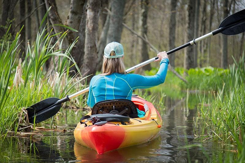 girl kayaking flatwater