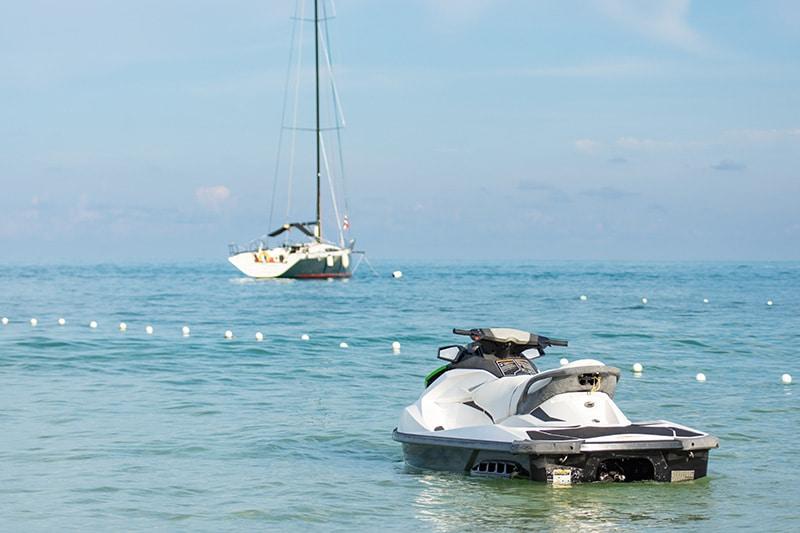 jet ski and sail boat