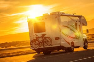 rv at sunset on road