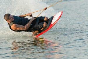 guy kneeboarding tricks