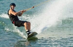 man riding wakeboard