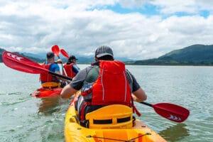 men in kayaks