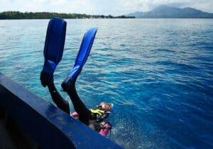 scuba diver off boat