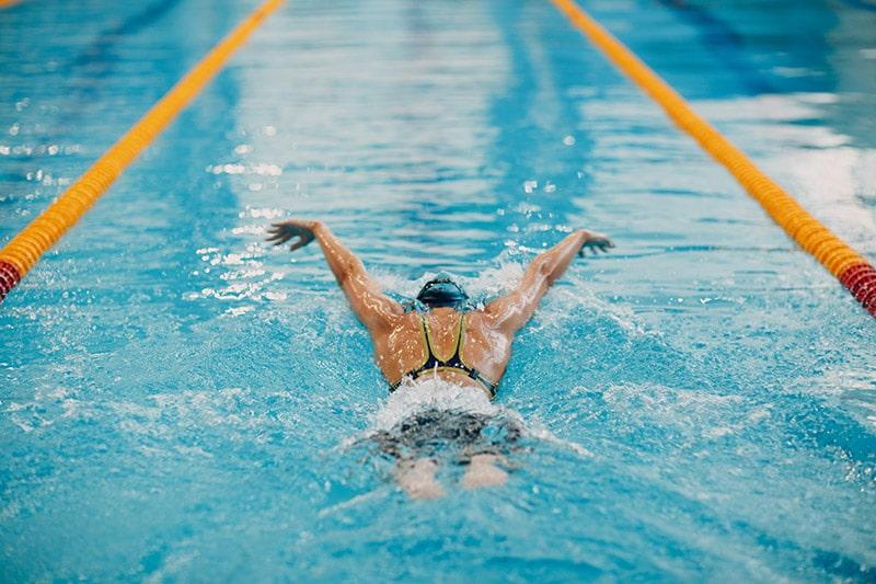 woman doing swim strokes