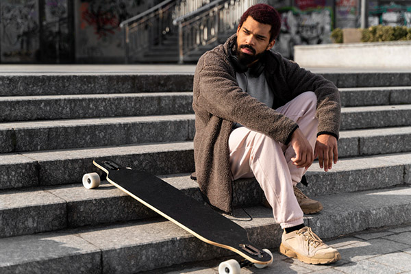 guy with longboard on steps
