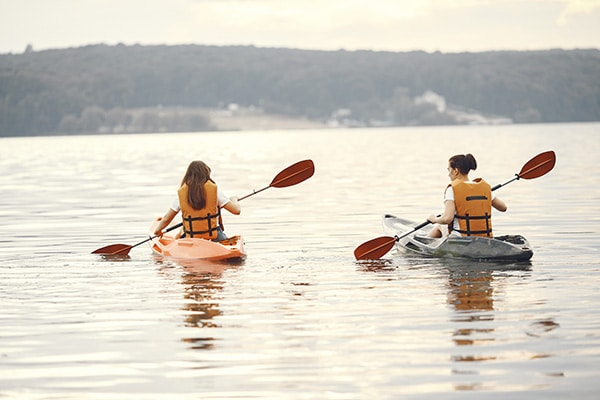 women on kayaks