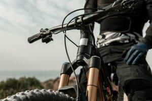 closeup man on mountain bike with gloves