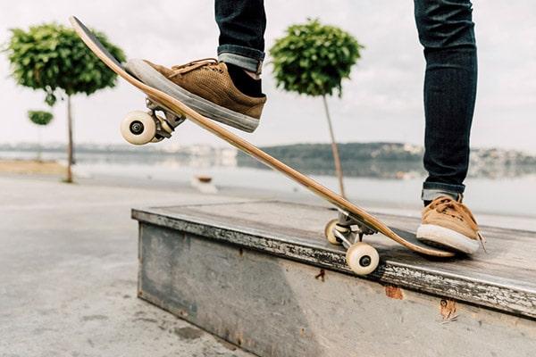 man balancing skateboard