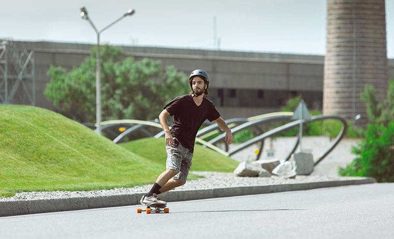 skateboarder carving