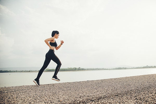 woman running by water