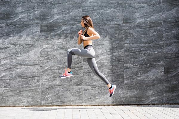 woman running and jumping