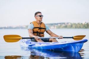 holding a kayak paddle