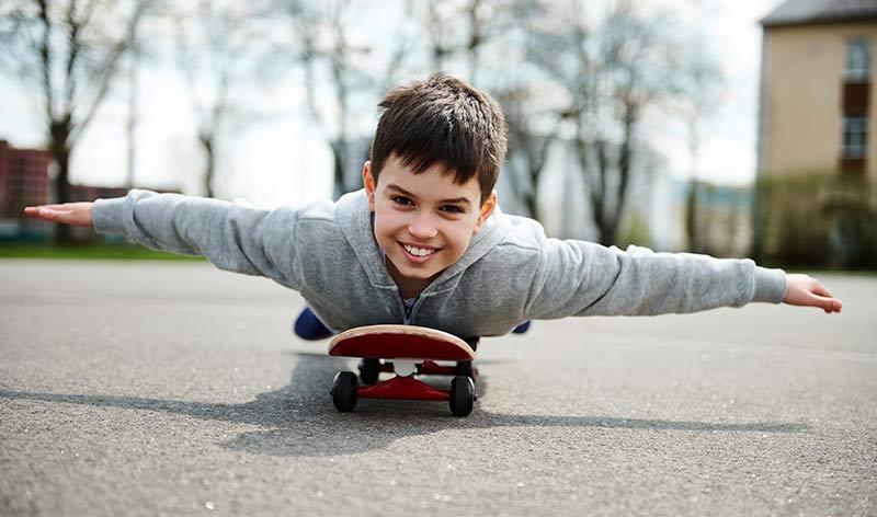 kid making airplane on skateboard