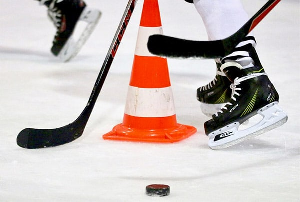 hockey skates on ice with puck
